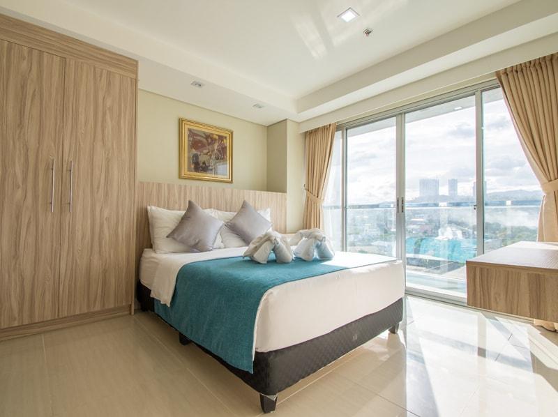 セブ島のアリシアアパーテルのベッドルーム